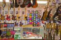 Guitar shop music store with many guitars strings and accessories Stock Photo