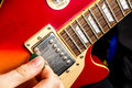 Guitar sun burst electric played by man Royalty Free Stock Images