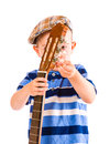 Guitar tune child years old tunes the white background Stock Image
