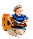 Guitar tune child years old tunes the white background Royalty Free Stock Photography