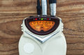 Guitar tuner details of an old solid built with dust on surface turned on Royalty Free Stock Images