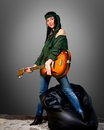 Guitar woman posing with an electric Royalty Free Stock Image