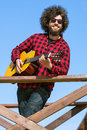 Guitarist with afro hair Royalty Free Stock Photo