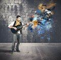 Guitarist with colorful splash effect Royalty Free Stock Image