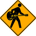 Guitarist Crossing Sign Stock Image