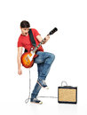 Guitarist man plays on the electric guitar Stock Photos