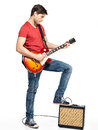 Guitarist man plays on the electric guitar with bright emotions isolatade white background Stock Photo