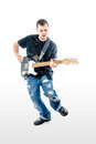 Guitarist musician isolated on white jumping a with black shirt blue jeans and blue guitar Stock Image