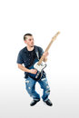 Guitarist musician isolated on white knees bent a with black shirt blue jeans and blue guitar with Royalty Free Stock Photography