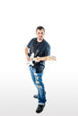 Guitarist musician on white looking forward a with black shirt blue jeans and blue guitar Royalty Free Stock Photography
