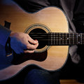 Guitarist playing acoustic guitar unplugged performance Royalty Free Stock Images