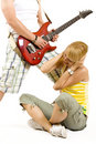 Guitarist playing an annoying song to a girl Stock Images