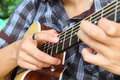 The guitarist tapping technic of guitar to fingerboard Stock Photo