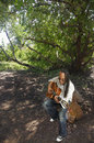 Guitarist under a tree Stock Images