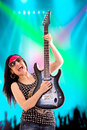 Guitarist woman in concert young performing during a Royalty Free Stock Images
