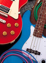 Guitars colorful electric and cables laying on the floor Royalty Free Stock Image