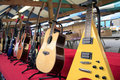 Guitars a market stall selling electric and acoustic at chesterfield market derbyshire england uk Royalty Free Stock Photos