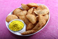 Gujia in plate with holi color in bowl indian traditional snacks for festival yellow Stock Image