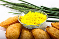 Gujia in plate with holi green color in bowl indian traditional snacks for festival Stock Photography