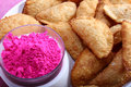 Gujias with pink color in bowl the traditional indian snack for holi festival Royalty Free Stock Images