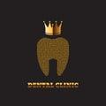 Guld tand med för bakgrundsstomatology för krona en mörk symbol för klinik Arkivfoton