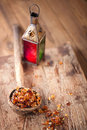 Gum arabic also known as acacia gum in old wooden spoon Stock Photos