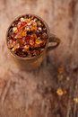 Gum arabic also known as acacia gum in wooden mug Royalty Free Stock Images