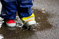 Gumboots and a puddle Stock Images