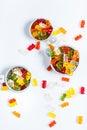 Gummi bears in bowls on white background Stock Photos