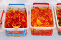 Gummy worms red in bulk boxes Stock Image
