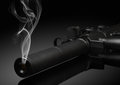 Gun barrel with smoke Royalty Free Stock Photo