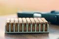 Gun with bullets. Handgun box with new ammunition. Royalty Free Stock Photo