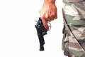 With a gun and camouflage pants close up over white background Stock Photography