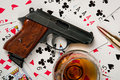 Gun cognac and cards Stock Photos