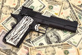 Gun and dollars Stock Photography
