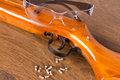 Gun, a few bullets and glasses Royalty Free Stock Photo