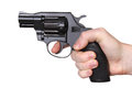 Gun in hand black revolver a on a white background Stock Photo