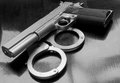 Gun and handcuffs Royalty Free Stock Images