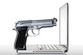 Gun on a laptop Royalty Free Stock Photography