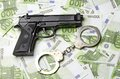 Gun and money Stock Image