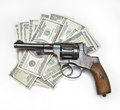 Gun and money Stock Images