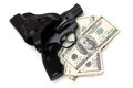 Gun and money a white background Stock Photography