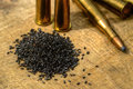 Gun powder and bullets with on wood board Stock Photography