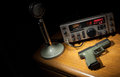 Gun and radio semi automatic handgun that is next to a microphone Stock Image