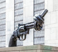 Gun tied in a knot outside un new york usa july headquarters as symbol for reaching peace new york city on july Stock Photography