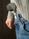 Gun tucked in waistband close up of a man with a into his Stock Image