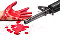 Gun violence a m rifle with bloody hands and blood drops Stock Image