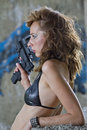 Gun woman gangster with handgun in profile posing outdoor Stock Photo