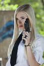 Gun woman in shirt and tie young holding a handgun dressed white blouse outdoor Stock Photo