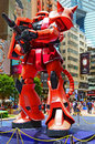 Gundam char zaku ii fans around giant figure of s on display at times square causeway bay hong kong Stock Image